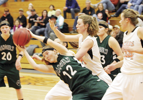 Rangely's lone senior on the lady Panther basketball team pulls down a rebound against Hayden while surrounded by Hayden players and teammates Brittany Babineaux (20) and Hailee Russell. The lady Panthers won the game and will host North Park this Saturday.