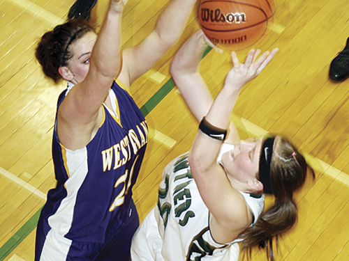 Rangely junior Brittany Babineaux, who led the lady Panthers with 16 points, goes up for a basket in the pigtail game the West Grand Mustangs, which Rangely won 52-32.  Babineaux and the lady Panthers will play Meeker in the first round of the district tournament Friday at 3 p.m. in Kremmling.