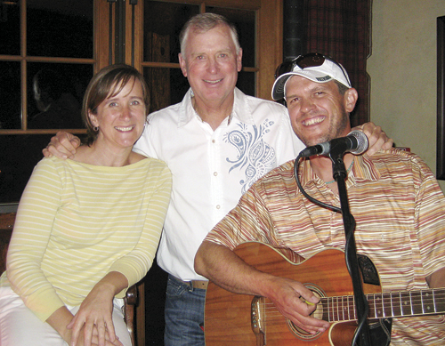 Matt and Shana Holliday playing music at Elk Creek with former vice president Dan Quayle in the audience.