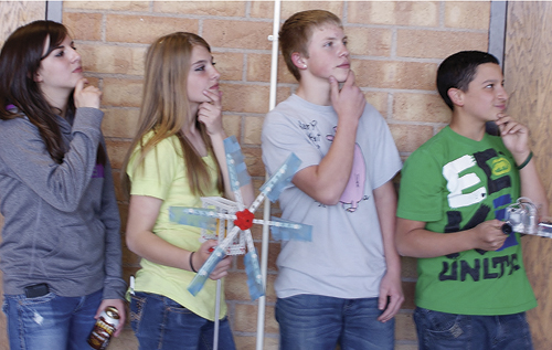 (From left to right) Courtney Bell and Justyne Dembowski (holding wind turbine); Jesse Odem and Kiki Ruiz (holding fuel cell car).
