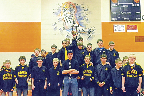 "The Barone Middle School wrestling team gathered on the podium to receive the trophy after winning the team championship in Hayden last Saturday. ""They sure were excited when they announced they won the team title,"" head coach Lee Overton said."
