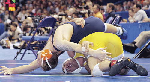 LeBlanc scores back points in a must-win match, which he did 13-6, against Dallago of Illinois, to become a four-time All-American