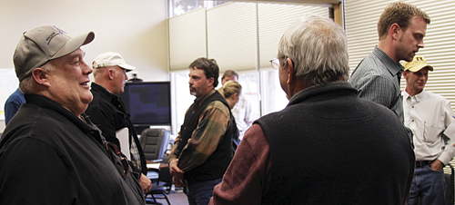 Lannie Massey, of Encana, speaks with RBC commissioner Ken Parson (foreground), while Mesa county commissioner Craig Meis chats with RBC commissioner chairman Shawn Bolton, and WSCOGA director David Ludlam and RBC commissioner Kai Turner (right).