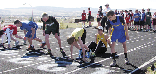 (Above) Rangely seventh-grader Patrick Scoggins waits for the starting gun to go off. Scoggins, like his older brother William, is a good runner, winning the 400-meter race in Craig Saturday last.