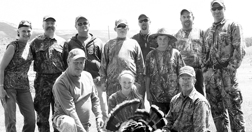 Officers, youth hunters and their parents pose proudly for the camera at Bel-Aire State Wildlife Area.