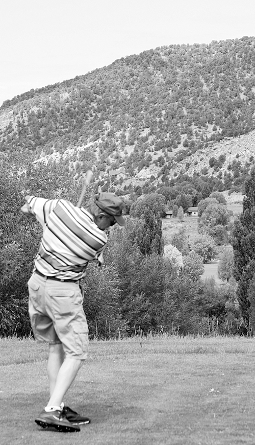 Local golfer Clint Chappell tees off No. 1 at the Meeker Golf Course last Sunday. Chappell finished with the second best gross score in the second flight.