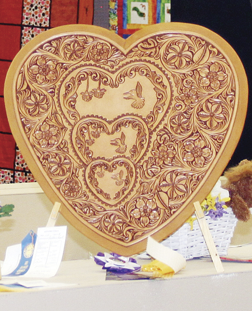 "Klenda and Brennan both share their knowledge and experience with local 4-H and he was awarded ""Best of Show at the recent RBC Fair for his leather heart, symbolic of he and Brennan's volunteerism to the local 4-H club and others in the community."