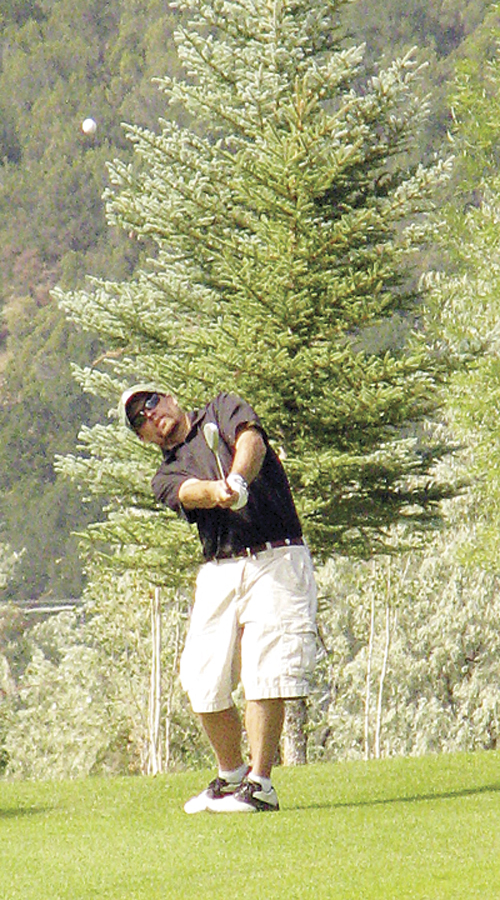 "J.C. Watt, pictured chipping onto the green on No. 8, defended his men's club championship with a one-shot victory last Saturday at the Meeker golf course. The humble champion did not know how many times he has been the club champion but smiled when asked if ""multiple times,"" would be correct."