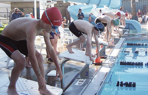 The Meeker Marlins concluded their summer swim meet schedule in Eagle last Friday at the High Country League Championships and all of Meeker's swimmers swam personal best times in their events, including Liam Deming, Zagar Brown and Chase Blaisdale (all wearing red caps) pictured ready to start the 25 Fly.