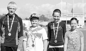 Several Rangely youngsters participated in the sectional Punt, Pass and Kick competition held in Grand Junction this past Saturday. Medals were awarded to the top three in each age group, (left to right) Patrick Scoggins, third; R.J. Richens; Katelyn Brown, first; Skylar Thacker, first. Mekenzie Morley (not pictured) placed third. The top finishers earning a chance to compete in the state championship at a Denver Bronco game in December. To participate in the state event their score must be in the top four of the nine sectional events held throughout the state and outlying areas.