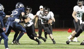 The RHS Panthers played Vail Christian Friday on their home field.  The Panthers won the game 30-6. Senior (No. 22) Colton Coombs rushing. (Left) Junior (No. 88) Ryan Wilzcek blocking.