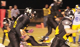 Meeker freshman T.J. Shelton follows teammate Sebastian Clarke against Roaring Fork. Shelton led the Cowboys with 188 yards rushing, helping his team defeat the Rams 34-9 and set a school record with 541 total offensive yards. Meeker will play their final game of the regular season Friday in Hotchkiss.