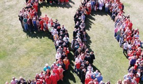 "Thanks to a few key staff members marking a large ""50"" in the grass, the town of Rangely for the use of a bucket truck and operator Paul Tucker, CNCC Photographer Denise Wade was able to get this photo of CNCC graduates, family and faculty making a ""Human 50"" to commemorate the beginning of the 50th year of higher education for the local college."