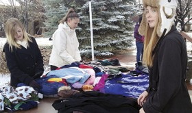 Sociology students Hannah Coleman, Quincey Thacker and Haeley Enterline (left to right) organize winter gear at last weekend's CNCC-sponsored coat giveaway.