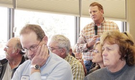 """We had no clue this was going to happen or we probably would have looked for a different way,"" said local businessman Joe Conrado (standing), about the public hearing and comments from adjacent landowners on their application to place a 199-foot communications tower on a parcel of their property on RBC Road 13 (Flag Creek Road)."