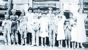 """A 1934 photo of students at the Lime Kiln Hill School included (back row) Milton Sykes, Armettia Toembly, Muriel Sterry, Earl Sterry, Elsie Sykes, Dorothy Sykes, Rex Sterry and teacher Eleanor Service. (Front row) Dick Moyer, Howard Sterry, George Sterry, Walter Moyer, Louise Sterry, Leonard Sykes, Marilyn Sykes, Iris Sykes and Alma Mae Sykes. The photo is from the third volume of the """"This Is What I Remember"""" series of books available for purchase at the White River Museum."""