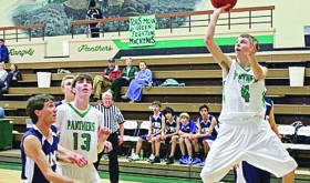 RHS Senior Cory Evans (4) making a shot against Vail Mountain.
