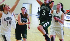 Rangelys Aimee Hogan makes two of her 12 points with a layup against Vail Christian, with junior classmate Chelsea Ficken following. The lady Panthers will host Paonia Friday and travel to Hotchkiss Saturday.