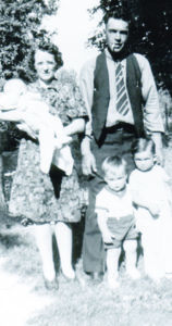 Patty as a baby, held by her mother Annie, with her father Dallas Collins and brothers Dick and Joe.