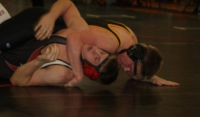 Cowboy senior J.R. Crawford scores back points in a regional tournament match last weekend in Grand Junction. Crawford finished third in the 170-pound bracket and qualified for the state wrestling tournament for a second time. Crawford and seven teammates will compete in the Colorado State Wrestling Championships, which starts today in the Pepsi Center at 3 p.m.