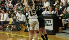 Senior, #20, Brittany Babineaux shooting against #15, senior Kaysyn Chintala