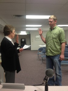 Meeker Town Clerk Lisa Cook (left) administers the oath of office to Bryce Ducey, the newest member of the Meeker Board of Trustees during the March 18 board meeting.