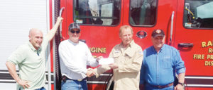 Summit Midstream Partners, a natural gas gathering company, gave the Rangely Rural Fire Protection District (RRFPD) $5,000 toward the purchase of two new fire trucks last week. The donationis in memory of Summit Midstream plant operator Tom Gough's 12-year-old son Collin Gough, who passed away last year. From left: Summit Midstream Partners Director of Operations Rick Smith, RRFPD Fire Chief Andy Shaffer, Summit Midstream plant operator Tom Gough and ice president of operations Joe Velasquez.