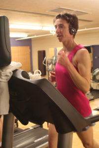 Sarah Ward, who registered for the Boston Marathon last fall and will run in the famous race this April, trains at the recreation center until warmer weather improves road conditions for running.