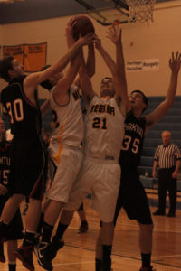 Meeker twins Alex and Scott Smith go up for a rebound against Haxtun in the first round of the regional tournament last Friday in Denver at Mullen High School. The Cowboys lost 34-55, making it the last game for the seniors, including the Smith twins, Nate Walsh, Fernando Villalpando, Stefan Cochran and Tala Atoafa, who all got to play in the regional game.