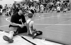 Rangely Youth Wrestling head coach Andy Lucero gets some one-on-one time with his 7-year-old son, Tyce, following Tyce's successful first match at the Parachute Grapplers Tournament over the weekend. Lucero, who took the program over from Jeff and Sharon Heinlein 2012 with wife Heidi and Rangely locals Lynn and Wade Rusher, said their efforts would be unsuccessful without the support of volunteer coaches and parents.
