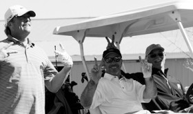Meeker golfers Ted Relihan and Bobby Castaldo flash double peace signs, while local golf pro Jim Cook only flashes one.