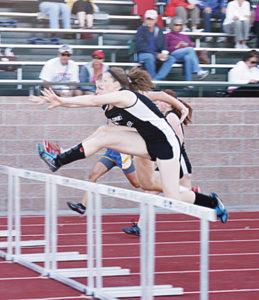 Meeker junior Aly Ridings is in second place here, but she caught up and became a 2A league and regional champion in the 100-meter hurdles.