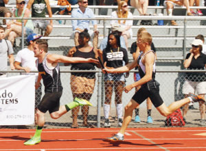 Meeker's Jeff Wagner receives the baton from Anthony Watt in this first exchange of the 4x100-meter relay team, which finished third.