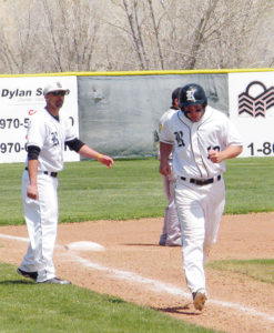 Panther head baseball coach Paul Fortunato congratulates senior Tobie Gasper as he rounds third base after hitting a home run to put his team on the scoreboard and start a comeback against Meeker. Rangely won the game 11-3 and will play Dolores on Friday at 8:30 a.m. in Delta.