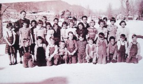This photograph was taken in front of the foundation of the new elementary school with Mrs. Massie's third-grade class of 1938-39 in front.