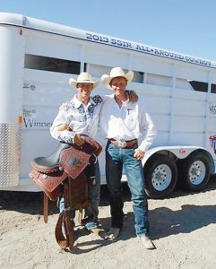 """Incoming CNCC freshman Wade """"Whiplash"""" Grimshaw poses with his SSIR All-Around-Cowboy saddle, buckle and horse trailer standing next to CNCC rodeo coach Jed Moore."""