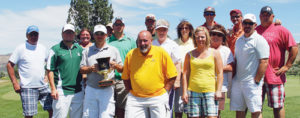 """Several members of Cedar Ridges Golf Course are pictured together after winning the Rio Blanco County Cup, a two-day, match play tournament in Rangely. Rangely displayed """"The Cup"""" after the first year but Meeker won the past three in a row. Pictured are Terry Richardson, Chris Hejl, Leilanie Morgan, Robby Elam (holding """"The Cup""""), Robbie Morgan, Ryan Elam, Rick Brady, Brian Mackay, LaVella Justus, Teresa Richardson, Cori Elam, Linda Gordon, Caleb and Jon Templeton, James Maybury and Jeff Blankenship."""