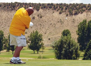 Rick Brady is pictured teeing off No. 1 at Cedar Ridges Golf Course. Brady played two matches Sunday, winning one and tying another.