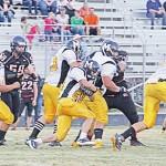 Cowboy senior J.C. Henderson following his blockers.
