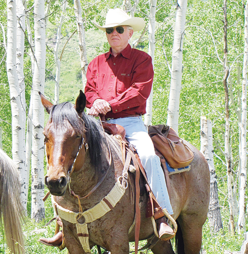 Richard Bachmann riding one of his horses on an aspen laced trail on the Wakara Ranch. The horse Bachmann is riding carries some of the original blood lines of the original ranch horses.