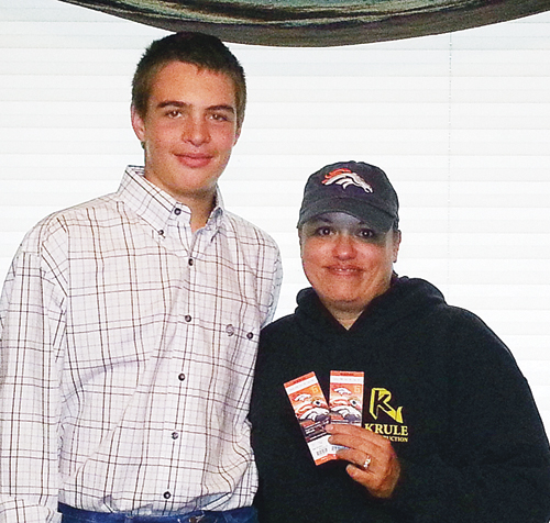 Ty Dunham, left, a member of the Meeker FFA Livestock Judging Team, sold the winning ticket in a fundraiser drawing to Olynna Pierson, right, for two tickets to watch the Denver Broncos defeat the Jacksonville Jaguars in Denver on Oct. 6. The remaining four prizes for the FFA fundraiser will be drawn during half time at the Donkey Basketball game that will be held at the Meeker High School gymnasium this evening. The FFA judging team will continue to sell tickets up until the game. Prizes still available are: a processed hog, cut and wrapped for two; a patio/deck fire pit; a Nancy Glazier framed elk print; and a half-day guided fly fishing lesson with Ryan Trout.