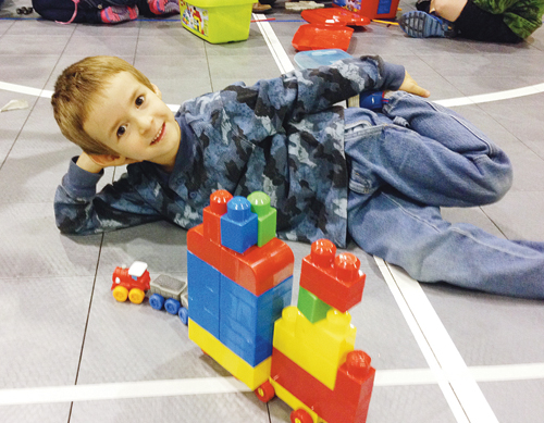 Rangely kindergartner Logan Benson smiles as he shows the vehicle he made with Lego Duplo blocks. Benson was one of approximately 65 children who attended Parkview Elementary School's inaugural Lego Club meeting last week. Preschoolers through fifth-graders are invited to attend the club's next meeting, set for Nov. 5.