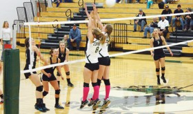 Meeker senior Aly Ridings spikes a ball over Plateau Valley defenders, with teammates Sydney Hughes, Piper Haney, Reagan Pearce and Taylor Neilson backing her up in a league match which the lady Cowboys won in three games. Meeker will host Paonia on Friday and Soroco on Saturday.
