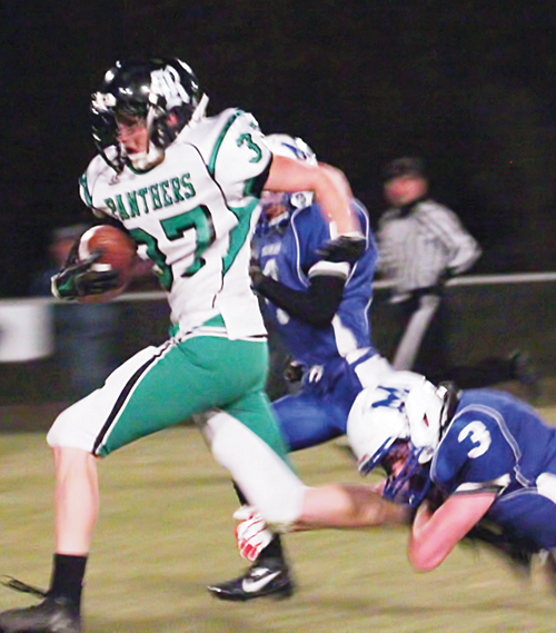 "Panther junior Colt Allred, named ""player of the game"" by coach Paul Fortunato, is pictured breaking a tackle after catching a pass and scoring a touchdown. Allred had five receptions for 182 yards, a touchdown and two-point conversion on offense, as well as leading the team with 11 tackles, one for a sack and a fumble recovery on defense."