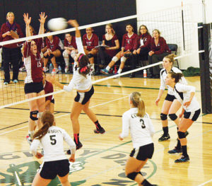 Meeker junior Paige Jones spikes the ball over the net against Telluride, with teammates Hughes, Neilson, Haney, Pearce and Ridings backing her up.