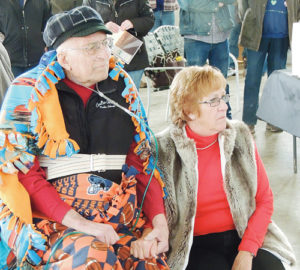 Gary, left, and Relda Coulter arrived back in Meeker last week from Craig, but Gary was completely surprised to show up at Meeker Airport on Saturday just in time for a small ceremony with about 80 persons to officially dedicate Coulter Field at the airport in his name. Coulter has been manager of Meeker Airport since 1959.