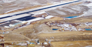 This is an aerial view of Coulter Field in Meeker with the hangars visible to the far left and the widened runway and taxiways visible on the right. The runway was widened from 60 feet wide to 100 feet wide, and it can now handle aircraft weighing up to 60,000 pounds, where the previous limit was 27,000 feet.