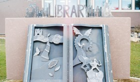 Metal artists bring library sign to life