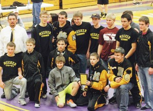 The Meeker Cowboy wrestling team, above, defending its team title at the West Grand Mustang tournament in Kremmling, dominated the competition and returned with 10 top-four placers, included four champions and the tournament's outstanding wrestler. Wrestling for the Cowboys this season are: Sheridan Harvey and Calvin Shepherd, holding the championship plaque, with Tristin Pelloni, Josh Cochran, Dillan Frantz and Devon Pontine, also with one knee down. In back are: volunteer assistant coach Carl Padilla, Anthony Watt, T.J. Shelton, Jake Henderson, Nick Burri, Casey Turner, Willis Begaye, assistant coach Barney LeBlanc, behind, and Chase Rule. Not pictured are Cody Nielsen, Kylloe Goedert and Tyler Ilgen.