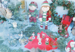"Angie Arnold, owner of Meeker Video, was one of the businesses in Meeker that went all-out, decorating the front window for a holiday season many business owners said was ""good to average"""